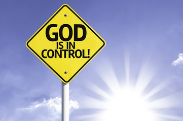 God is in Control road sign with sun background