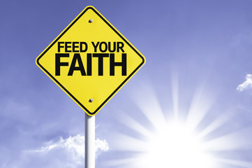 Feed your Faith road sign with sun background