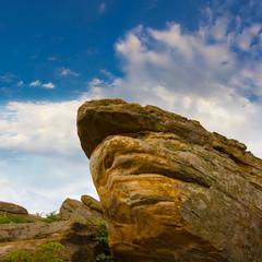 huge stone on a blue sky background