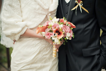 Wedding couple with brides bouquet