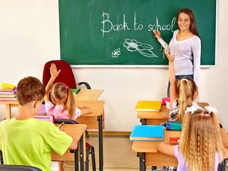 Children in classroom with teacher.