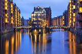 Illuminated house and two brides in Speicherstadt, Hamburg - 68957304