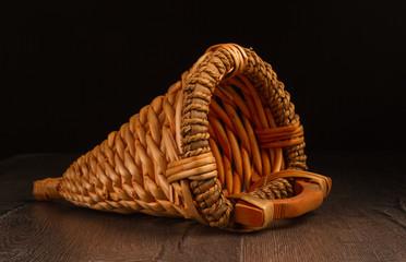 Wicker basket isolated on dark background