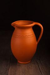 Vintage ceramic pot on wooden table
