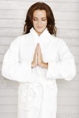 Woman in white bath robe