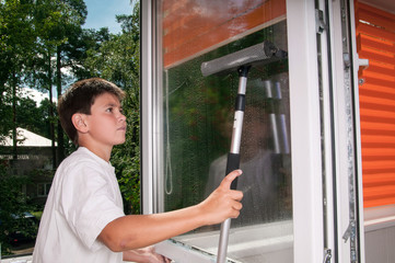 Young male window cleaner