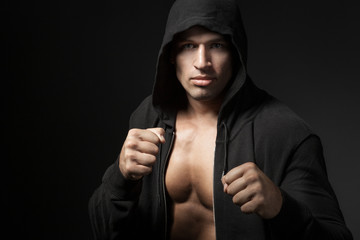 strong man fighter portrait isolated on black background