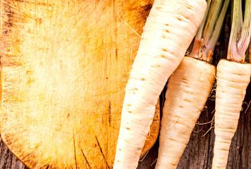 fresh parsley root on cutting board