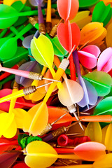 close up of colorful plastic darts