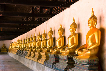 Row of sacred Buddha images in Putthaisawan Temple, Ayutthaya