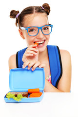 Schoolgirl eating healthy lunch