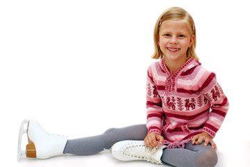 Young girl sitting on ice in skates on a white background