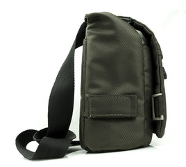 A small dark green sling bag on white background