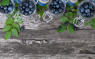 Wooden background with blueberries