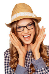 Portrait of a surprised young model in a hat and glasses with mo