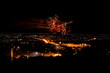 Fireworks in night cityscape.