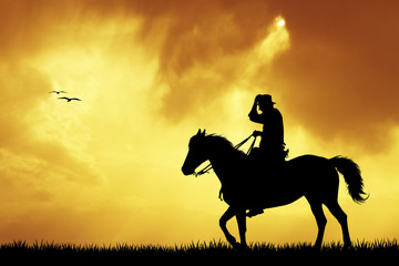 cowboys silhouette at sunset