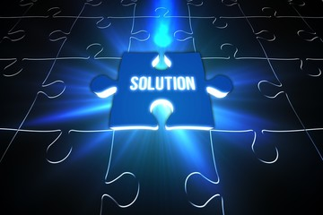 Blue solution glowing jigsaw piece on puzzle