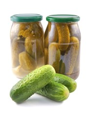 Cucumbers, Pickled and Canned in a jar, as well fresh loose