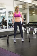 Full length of a fit woman in gym