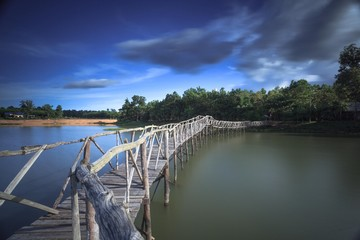 Wooden bridge crossover reservoir southern of Thailand