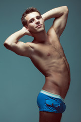 Male underwear fashion concept. Young man in blue undershorts