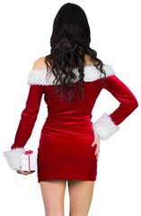 Sexy girl in santa outfit holding gift