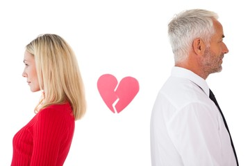 Couple not talking with broken heart between them