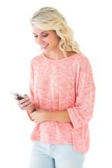 Pretty blonde using her smartphone