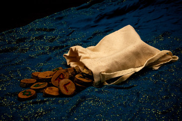 divination runes on blue cloth