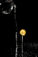 Pouring water in to a tall glass
