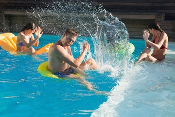 People playing in the swimming pool