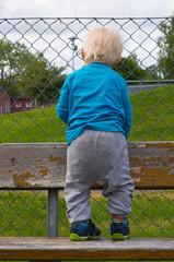 Blonde child on bench