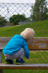Blonde child on bench