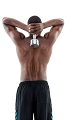 Rear view of a fit shirtless man lifting dumbbell