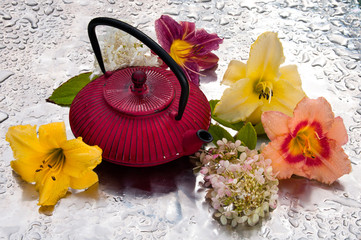 tea ceremony: tea pot with flowers on a rainy day