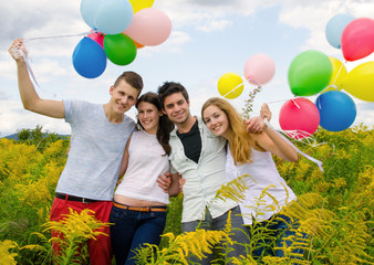 Happiness: Young couples with colorful balloons :)