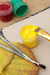 Bright yellow paint with brushes