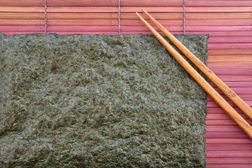 Sheets of Japanese dry seaweed with chopstick