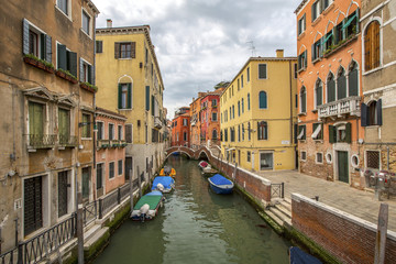 venetian channel with gondolas in Venetia Italy