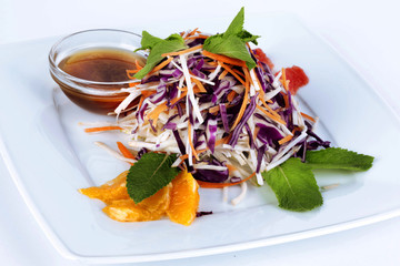 salad with red cabbage, carrots, oranges and mint
