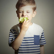 Funny Child eating apple.Little Boy.Health food.Fruits.Vitamin