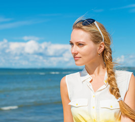 Portrait of the beautiful girl on the beach.
