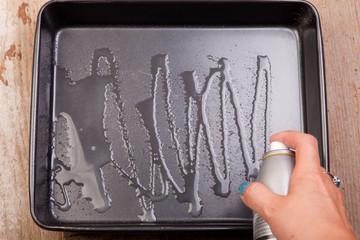 spray oil in backing tray