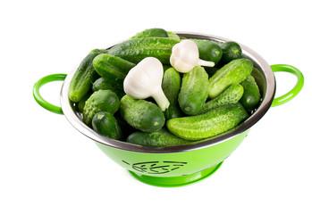 fresh cucumbers in a green colander