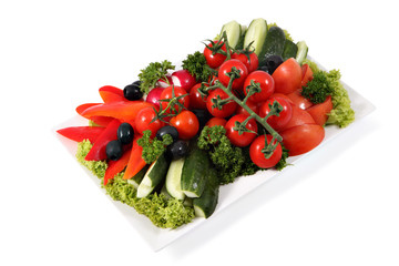 Assorted vegetables on plate isolated on white background.
