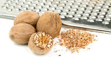nutmeg with grinder isolated on white