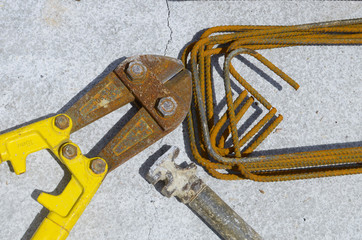 costruction equipment: scissor hammer shaped iron brackets