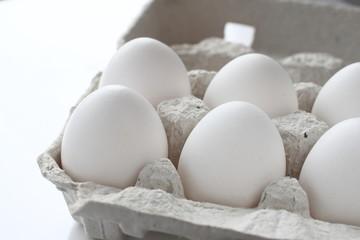 White chicken raw eggs in a box
