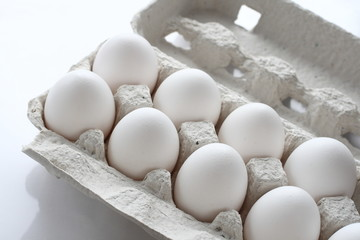 White chicken raw eggs in a box